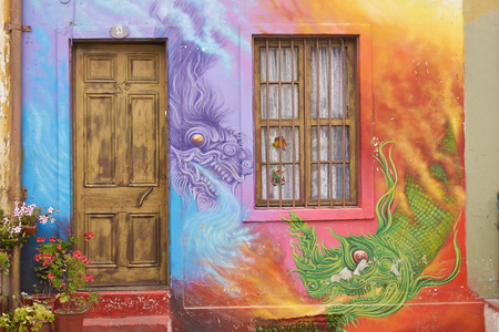 Valparaiso, Chile - January 19, 2015: Colourful murals decorating the walls of buildings in the historic port city of Valparaiso in Chile.