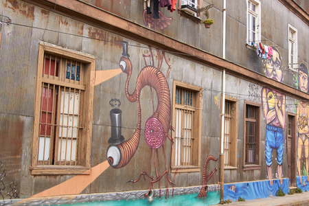 worm snake: Valparaiso, Chile - January 19, 2015: Colourful murals decorating the walls of buildings in the historic port city of Valparaiso in Chile.