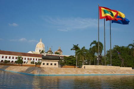 Flags flying above monuments to past events in the Parque de la Marina in the historic city of Cartagena de Indias in Colombia photo