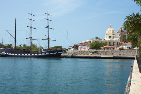 walled: Sailing ship tied up on the waterfront of the historic Spanish colonial city of Cartagena in Colombia. Editorial