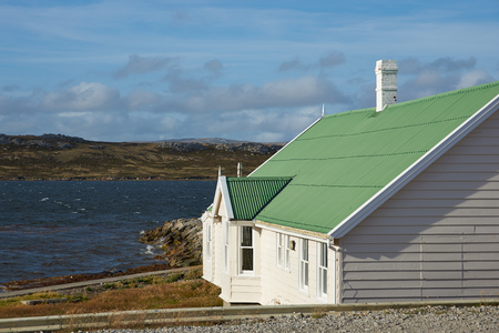sheltered: White building with green roof next to the sheltered bay at Stanley, capital of the Falkland Islands Editorial