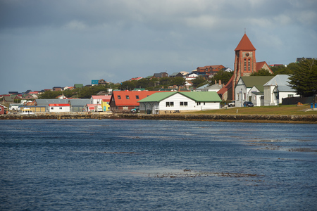 Historic buildings along the sea shore in the small town of Stanley, capital of the Falkland Islands.