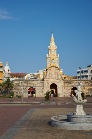 walled: Cartagena de Indias, Colombia - January 29, 2015: Historic Clock Tower (Torre del Reloj) above the main gateway into the historic walled city of Cartagena de Indias in Colombia Editorial