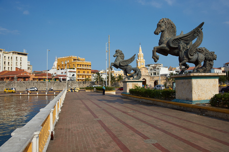 pegasus: Cartagena de Indias, Colombia - January 29, 2015: Large statues of Pegasus, the flying horse, on the road leading to the historic Clock Tower (Torre del Reloj) and main gateway into the historic walled city of Cateragena de Indias in Colombia