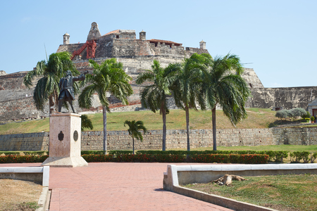 barajas: Historic castle of San Felipe De Barajas on a hill overlooking the Spanish colonial city of Cartagena de Indias on the coast of Colombia. Statue of Blaz de Lezo in the foreground. Editorial
