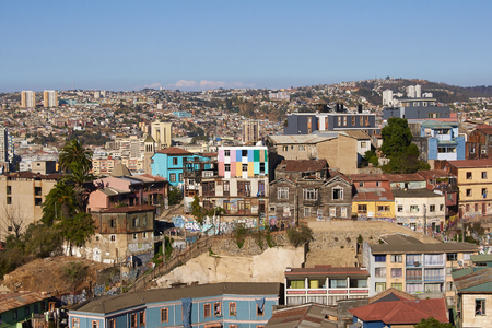 colourfully: Colourfully decorated houses crowd the hillsides of the historic port city of Valparaiso in Chile. Editorial