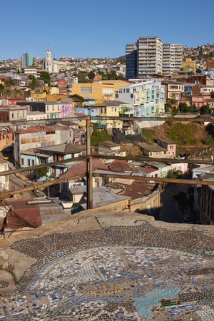 colourfully: Colourfully decorated houses crowd the hillsides of the historic port city of Valparaiso in Chile. Stock Photo