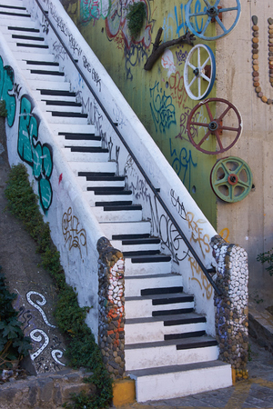 color wall: Valparaiso, Chile - April 16, 2015: Stairway decorated to look like the keyboard of a piano in the UNESCO World Heritage port city of Valparaiso, Chile. Editorial
