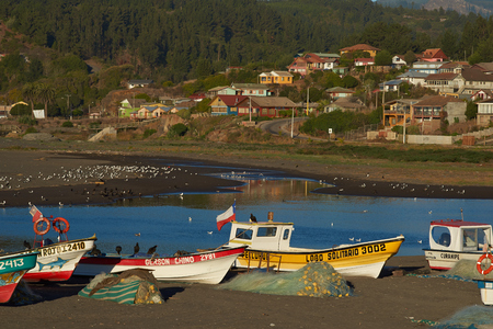 Curanipe, Chile - April 20, 2015: Colourful fishing boats on the beach in the small fishing village of Curanipe in the Maule Region of Chile.