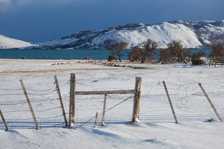 covered fields: Snow covered fields and mountains around Laguna Verde during winter in Torres Del Paine National Park in Patagonia Chile