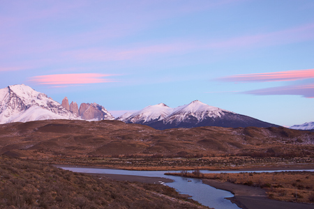 spires: Sunrise over the granite spires that give the name to the Torres del Paine National Park in Patagonia, Chile.