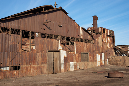 industrial heritage: Humberstone, Chile - July 1, 2015: Derelict and rusting industrial building at the historic Humberstone Saltpeter Works in the Atacama Desert near Iquique in Chile. The site is now an open air museum and a Unesco World Heritage SIte.