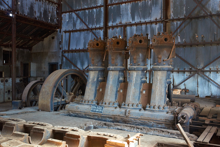 industrial heritage: Humberstone, Chile - July 1, 2015: Derelict and rusting machinery inside a corrugated iron building at the historic Humberstone Saltpeter Works in the Atacama Desert near Iquique in Chile. The site is now an open air museum and a Unesco World Heritage SIt