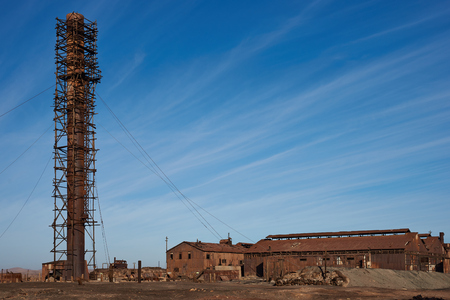 industrial heritage: Humberstone, Chile - July 1, 2015: Derelict and rusting industrial buildings at the historic Humberstone Saltpeter Works in the Atacama Desert near Iquique in Chile. The site is now an open air museum and a Unesco World Heritage SIte. Editorial