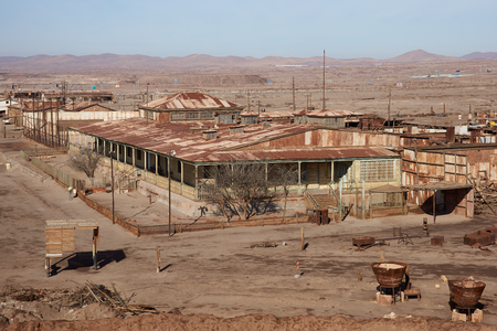 administrative buildings: Humberstone, Chile - July 1, 2015: Derelict and rusting administrative buildings at the historic Humberstone Saltpeter Works in the Atacama Desert near Iquique in Chile. The site is now an open air museum and a Unesco World Heritage SIte. Editorial