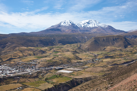 dormant: Small town of Putre in the Arica and Parinacota region of northern Chile. The small town sits in a fertile valley below the dormant Taapaca volcano 5860 m.
