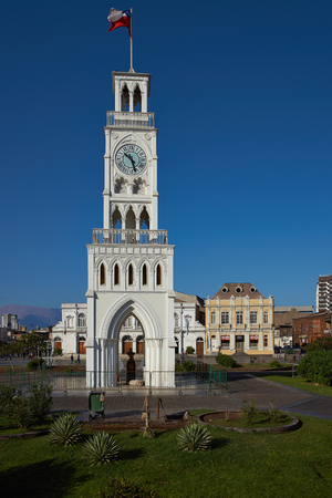arturo: IQUIQUE, CHILE - JULY 7, 2015: Historic clock tower in Plaza Arturo Prat in the old quarter of Iquique on the Pacific coast of northern Chile. Built circa 1877.