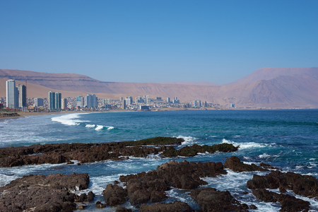 coastal city: Coastal city of Iquique in northern Chile located between the waters of the Pacific Ocean and sand dunes of the Atacama Desert.