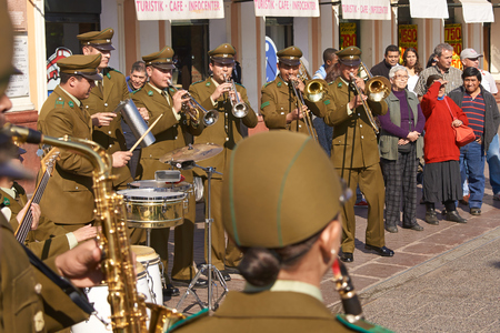 playing the market: Santiago, Chile - August 31, 2015: Carabinero music band playing outside the historic fish market in the centre of Santiago in Chile.