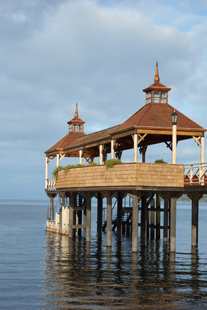 out of town: Wooden pier stretching out over the calm waters of Lake Llanquihue in the small town of Frutillar in southern Chile