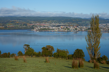 inlet: Castro, the capital of Chiloe Island in Chile. Small city located in a rural setting on the far side of a sheltered inlet.