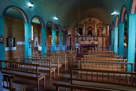 jesuit: Interior of historic wooden church, Iglesia de Colo, built in the 17th century by Jesuit missionaries on the island of Chiloe in Chile. Editorial