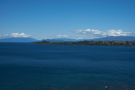 metres: Snow capped Volcanoes Osorno 2,652 metres and Calbuco 2,105 metres on the edge of Llanquihue Lake in Southern Chile. Viewed from Puerto Varas.