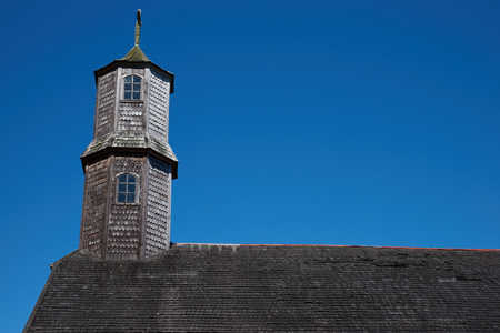 colo: Tower of historic wooden church, Iglesia de Colo, built in the 17th century by Jesuit missionaries on the island of Chiloe in Chile. Stock Photo