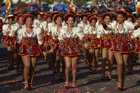 knickers: ARICA, CHILE - JANUARY 23, 2016: Female members of a Caporales dance group in ornate red and white costumes performing at the annual Carnaval Andino con la Fuerza del Sol in Arica, Chile.