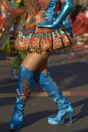 red and blue: ARICA, CHILE - JANUARY 23, 2016: Morenada dancer in traditional Andean costume performing at the annual Carnaval Andino con la Fuerza del Sol in Arica, Chile.