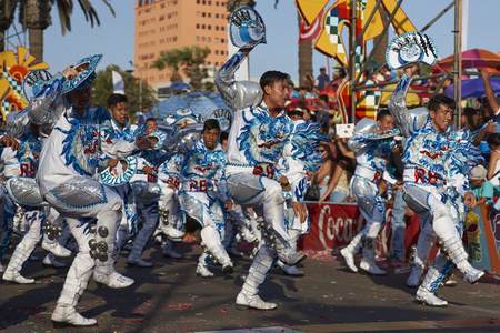 knickers: ARICA, CHILE - JANUARY 24, 2016: Caporales dance group in ornate costumes performing at the annual Carnaval Andino con la Fuerza del Sol in Arica, Chile.