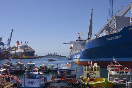 boast: VALPARAISO, CHILE - FEBRUARY 04, 2016:  Variety of ships and boast in the busy harbour of the UNESCO World Heritage port city of Valparaiso in Chile.