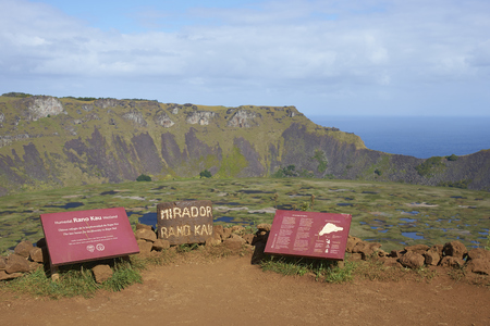 rapa nui: EASTER ISLAND - APRIL 6, 2016: Information signs on the edge of the caldera of the extinct volcano Rano Kau within the UNESCO World Heritage Site of Rapa Nui National Park on Easter Island.