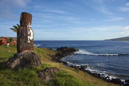 rapa nui: Lone moai statue on the coast of Rapa Nui (Easter Island) in the capital Hanga Roa.