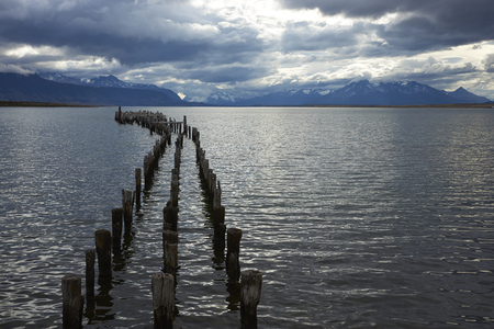 puerto natales: Derelict wooden pier stretching out into the sea at Puerto Natales in Patagonia, Chile