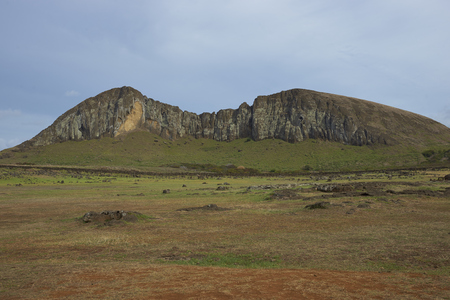 rano raraku: Ahu Tongariki. Site of a large group of ancient Moai statue on the coast of Rapa Nui (Easter Island). In the background is Rano Raraku, from where the statues were carved.