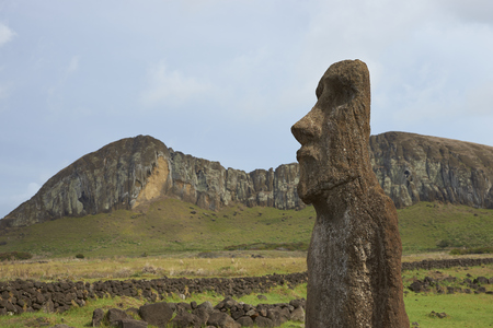 nui: Ahu Tongariki. Ancient Moai statue on the coast of Rapa Nui (Easter Island). In the background is Rano Raraku, from where the statues were carved.