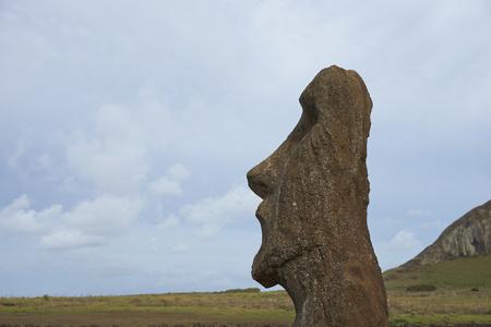 rapa nui: Ahu Tongariki. Ancient Moai statue on the coast of Rapa Nui (Easter Island). In the background is Rano Raraku, from where the statues were carved.