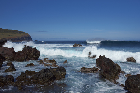 nui: Waves coming ashore on the rocky coast of Easter Island (Papa Nui) in the Pacific Ocean