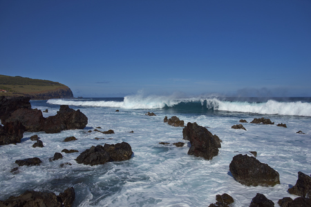 ocean waves: Waves coming ashore on the rocky coast of Easter Island (Papa Nui) in the Pacific Ocean