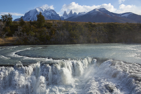 magallanes: The waterfall Cascada Paine on the River Paine in Torres del Paine National Park in the Magallanes region of southern Chile.