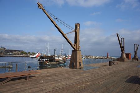 shipped: ANTOFAGASTA, CHILE - MAY 16, 2016: Historic pier in the city of Antofagasta in Chile. from where the produce from nitrate mining in the 18th and 19th centuries was shipped around the world. Editorial