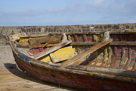 flaking: Derelict wooden boat on the quayside in the fishing harbour of Antofagasta in northern Chile.