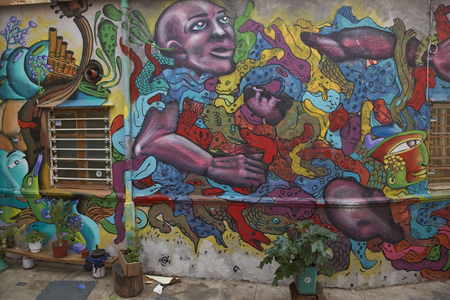 window graffiti: VALPARAISO, CHILE - JULY 1, 2016: House decorated with murals and urban art in the   city of Valparaiso on the Pacific Coast of Chile. Editorial