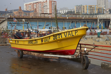 dockside: VALPARAISO, CHILE - JULY 1, 2016: Fishing boat on the dockside of the fishing harbour in Valparaiso, Chile. Editorial