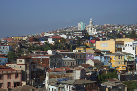 hillsides: Colourfully decorated houses crowd the hillsides of the historic port city of Valparaiso in Chile. Stock Photo