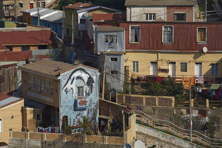 colourfully: VALPARAISO, CHILE - JULY 5, 2016: Colourfully decorated houses crowd the hillsides of the historic port city of Valparaiso in Chile. Editorial