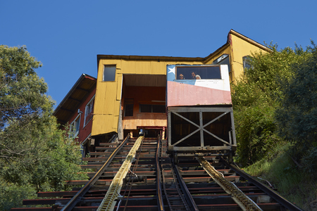 VALPARAISO, CHILE - JULY 5, 2016: Historic funicular (Ascensor Concepcion), constructed around 1880, taking passengers up and down the steep hills of Valparaiso in Chile.