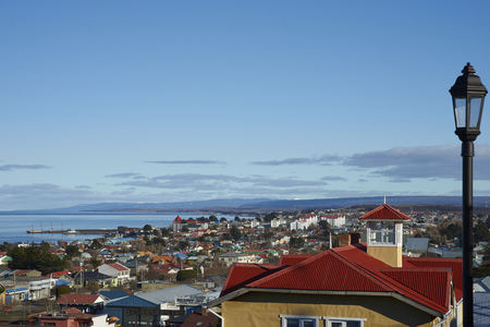PUNTA ARENAS, CHILE - AUGUST 25, 2016: Colourful rooftops of Punta Arenas in southern Chile overlooking the Strait of Magellan.