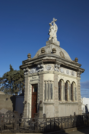 PUNTA ARENAS, CHILE - AUGUST 27, 2016: White marble mausoleum in the historic cemetery of Punta Arenas in the Magallanes Region of southern Chile Editorial